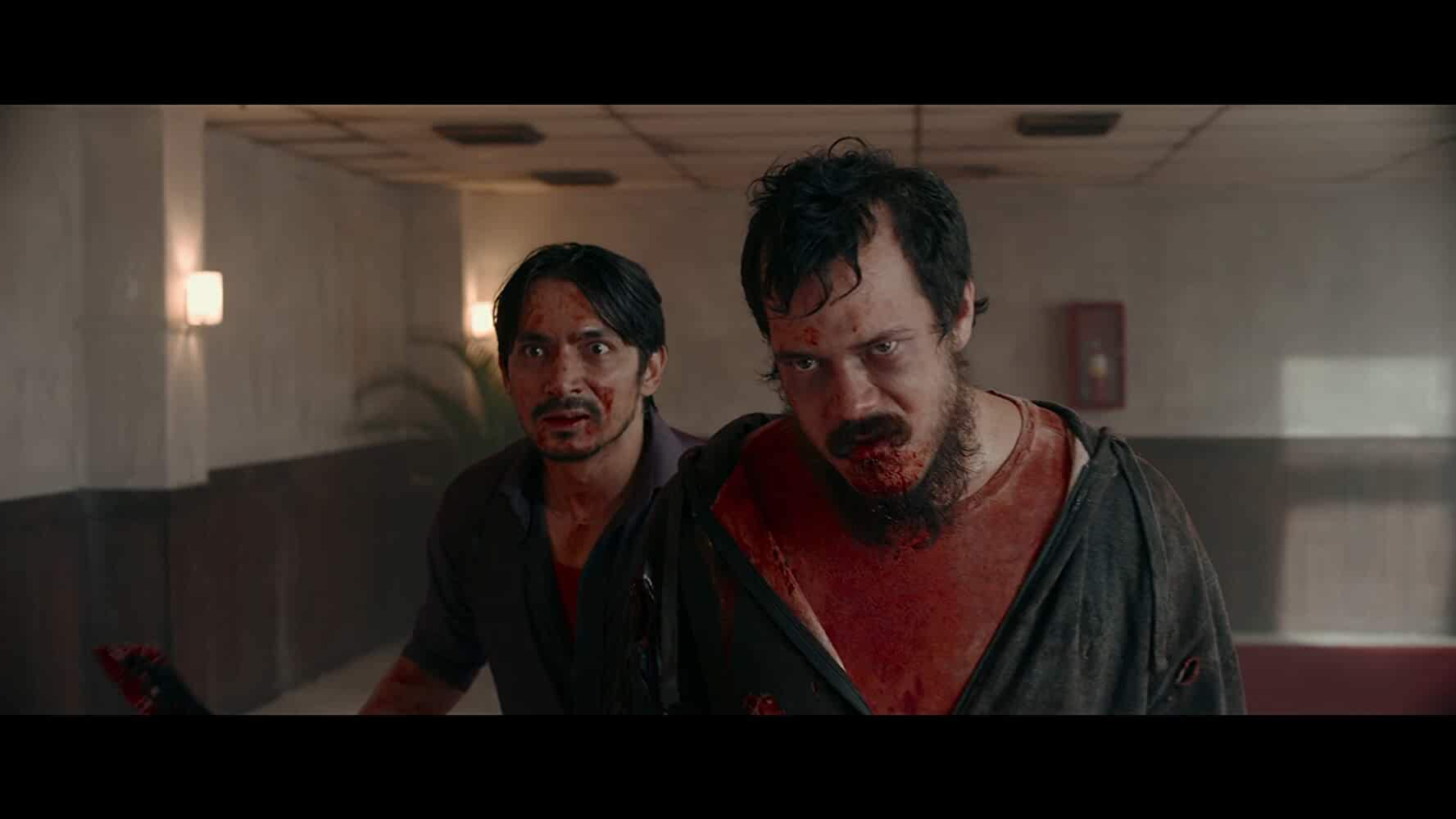 Abimana Aryasatya and Zack Lee in The Night Comes for Us (2018)